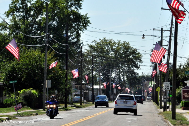 American flags fly along Fourth Steet in Paden City, West Virginia