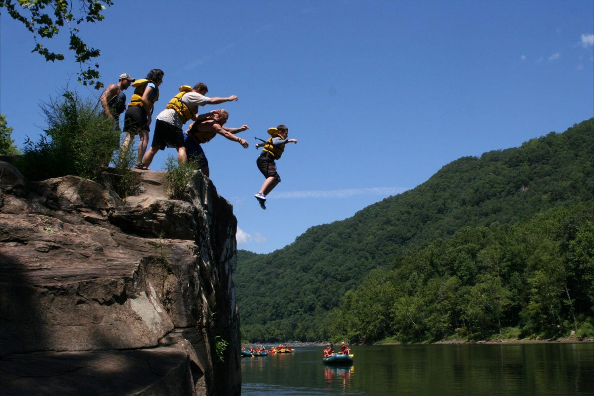 Swimmers leap into New River