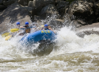 Rafters plow through rapid on New River, ACE Adventure Resort