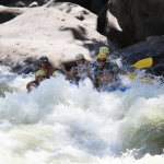 Banking through a New River rapid, ACE Adventure Resort