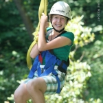 Young canopy-tour enthusiast on zip line, ACE Adventure Resort