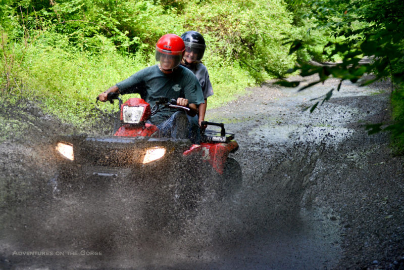ATV riders plow through New River mud