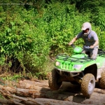 ATV drives across logs at Burning Rock Outdoor Adventure Park, Sophia, WV, Hatfield & McCoy Region