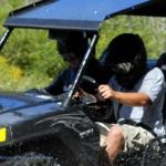 ATV driving through mud at Burning Rock Outdoor Adventure Park