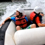 Youths rafting on New River