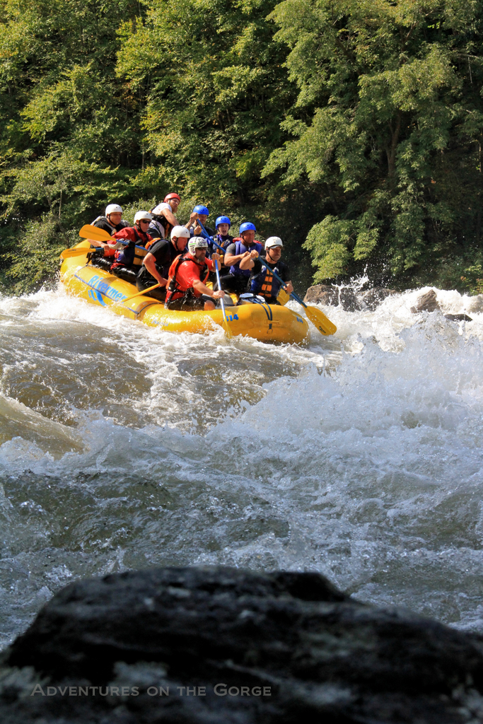 Paddling into a Gauley River rapid