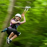Guest on zip line at River Riders, Harpers Ferry, WV