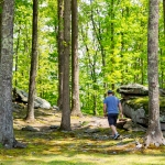 Hiker wanders among rocks near River Expeditions, Fayetteville, New River Gorge Region