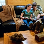 Guests relax in River Expeditions cabin, Fayetteveville, West Virginia, New River Gorge Region