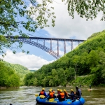 Paddlers gather near New River Gorge Bridge