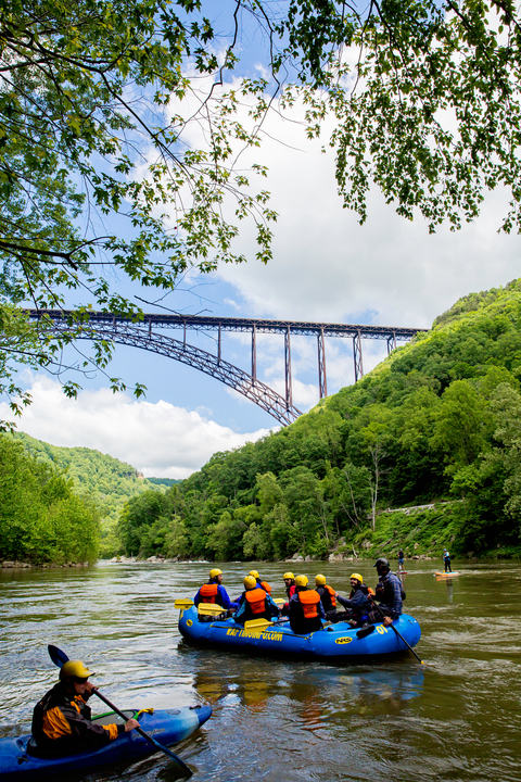 Paddlers gather near New River Gorge Bridge