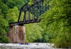 Rafters paddle beneath historic New River railroad trestle
