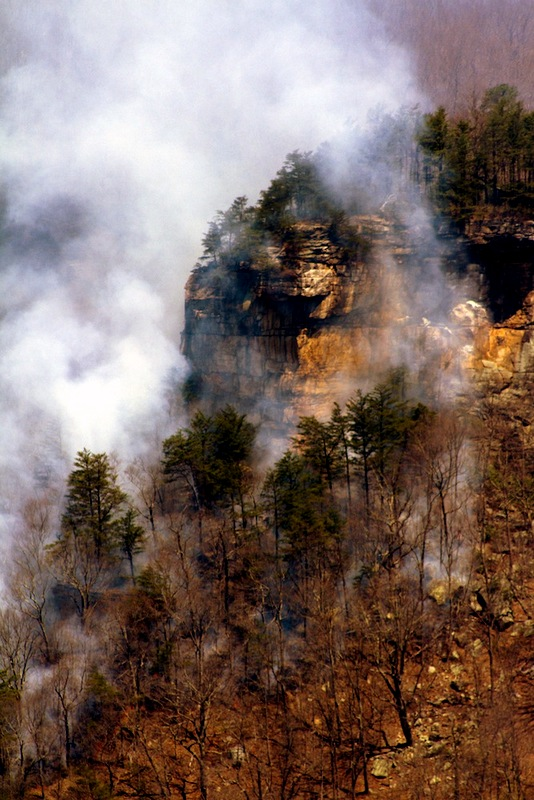Forest fire burning southeast of New River Gorge Bridge