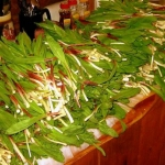A table full of ramps is ready for cooking.