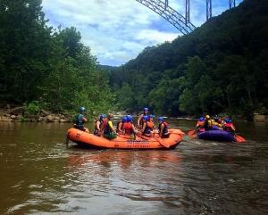 Rafts gather beneath the New River Gorge Bridge
