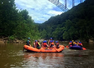 Rafts gather beneath the New River Gorge Bridge