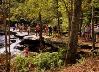 Hikers visit falls at Beckley Mill, Beckley, Raleigh County