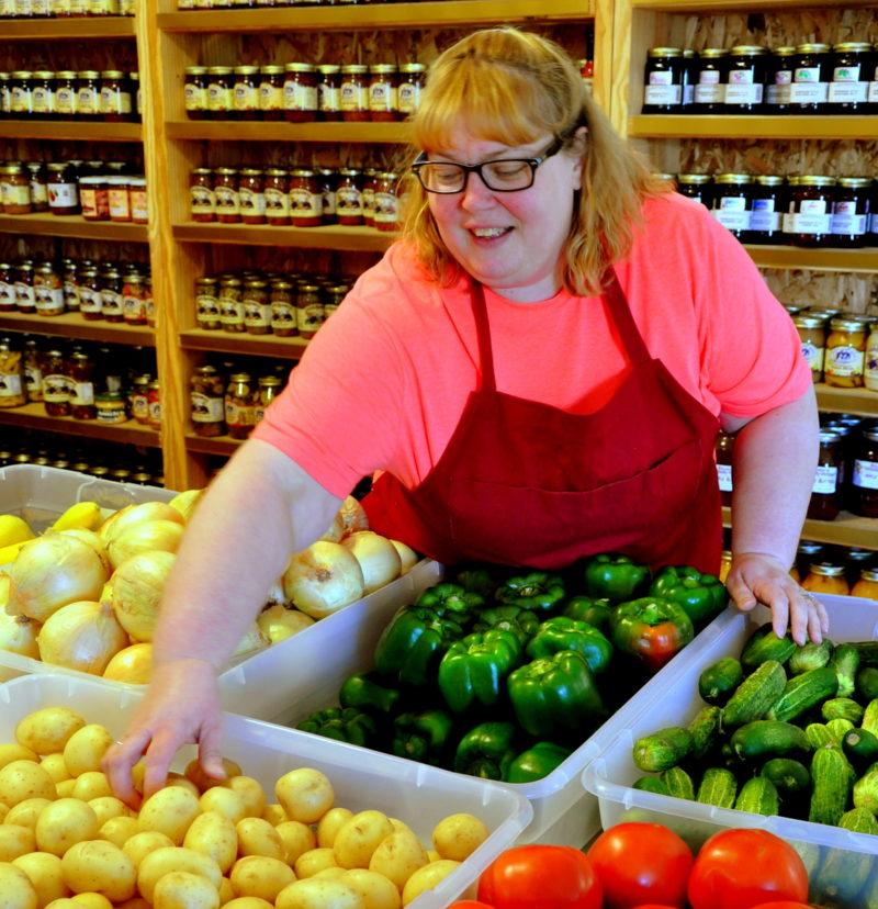 Grocer Joyce Brenemen stocks fresh veggies