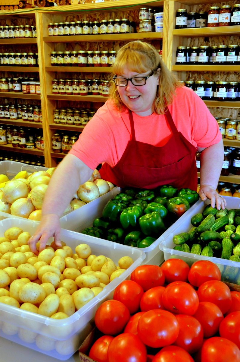 Grocer Joyce Brenemen stocks fresh veggies
