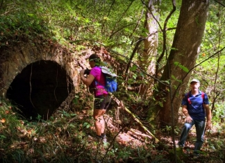 Hikers peer into a coke oven on New River