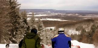 Snowboarders overlook the Canaan Valley from Canaan Valley Resort.