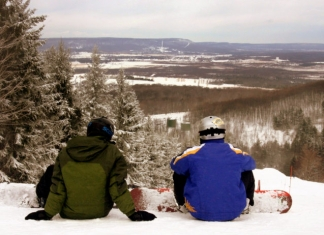 Snowboarders overlook the Canaan Valley from Canaan Valley Resort.