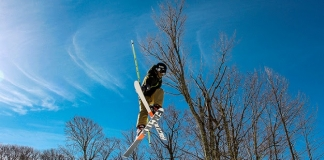 A skier at Canaan Valley Resort is captured in mid-jump.