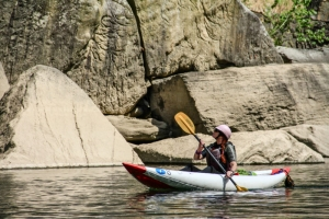 A kayaker explores boulders in the Dries of New River.