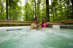 Couple in hot tub at Country Road Cabins