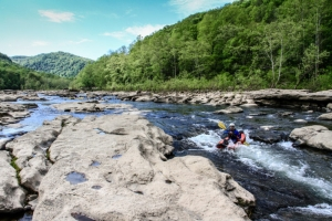 Paddlers navigate islands of sandstone in the Dries of the New River.