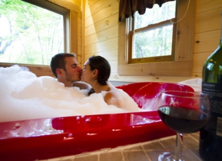 A couple soaks in a heart-shaped tub at County Road Cabins