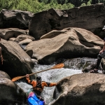 A kayaker descends through a chute in the Dries of New River.