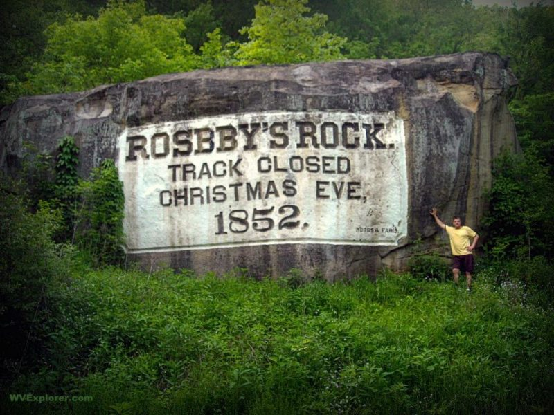 Sibray stands alongside Rosby's Rock, Marshall County