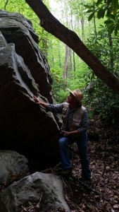 West Virginia Explorer editor David Sibray explores a cliff in a West Virginia forest.