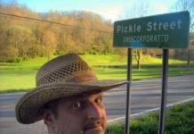 Editor David Sibray at Pickle Street sign