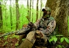 A hunter calls a gobbler during spring turkey season in West Virginia.