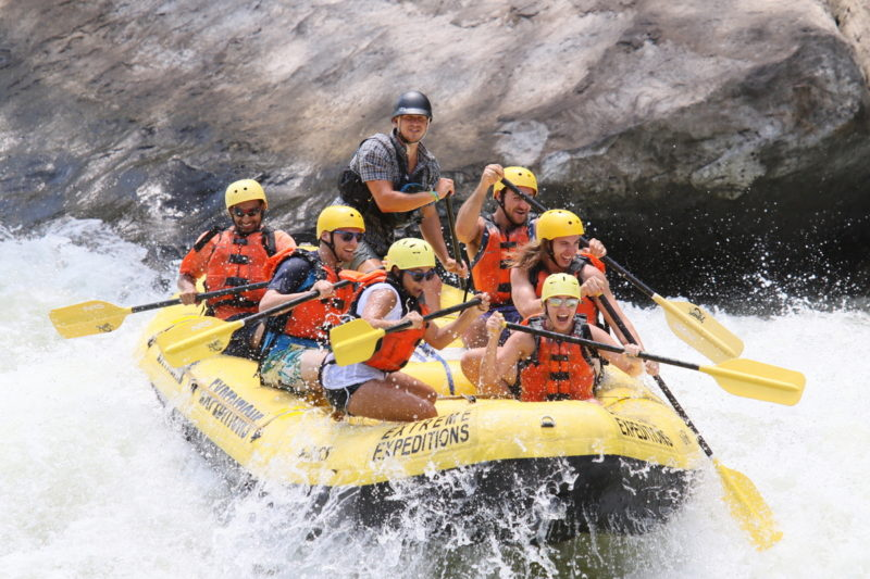 Excited rafters plunge into a rapid on New River.