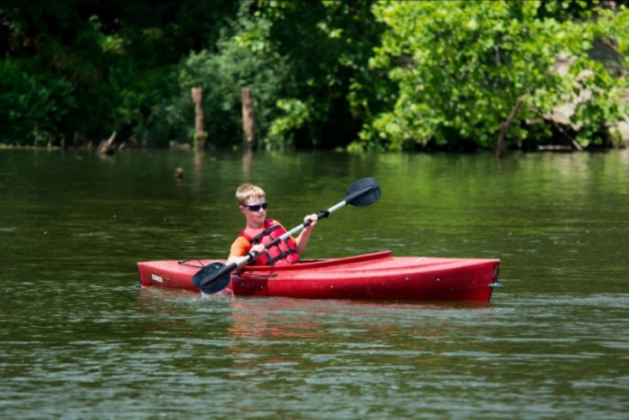 A youth canoes at Beech Fork State Park.
