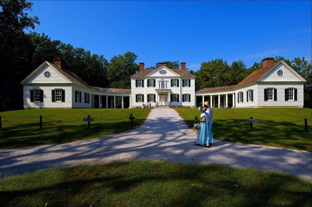 Re-enactors stroll the grounds of the Blennerhassett Mansion on Blennerhassett Island.