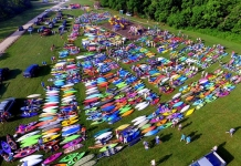 Kayaks await the annual Tour de Coal near the Upper Falls on the Coal River.