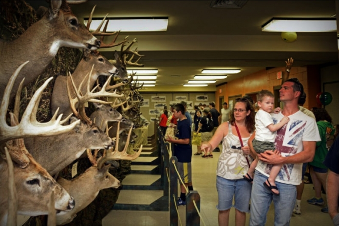 A family visits the National Hunting and Fishing Day display in West Virginia.