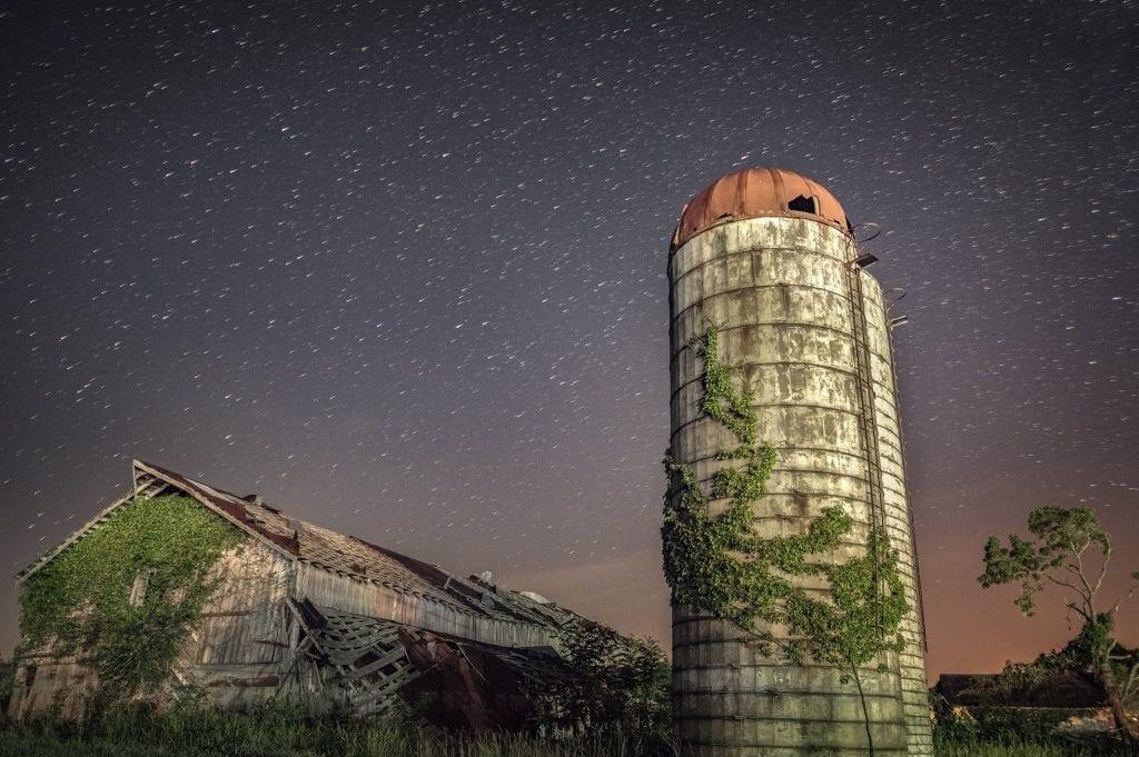 Stars travel the sky above a barn near Apple Grove.
