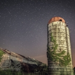 Stars travel the sky above a barn near Apple Grove.