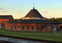 The setting sun casts a ruddy light on the B&O Roundhouse at Martinsburg, West Virginia.