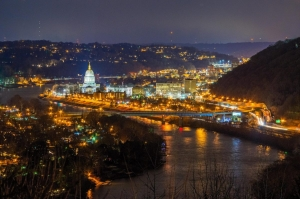 The lights of Charleston shimmer in the Kanawha River.