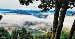 Fog shrouds Williamson, W.Va., as seen from Death Rock.