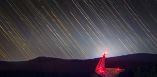 The Byrd Telescope glows red in the darkness at Green Bank.