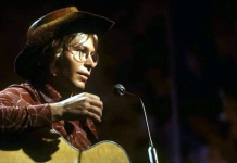 John Denver performs