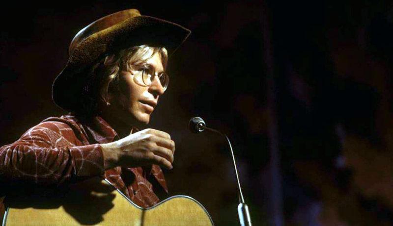 John Denver performs