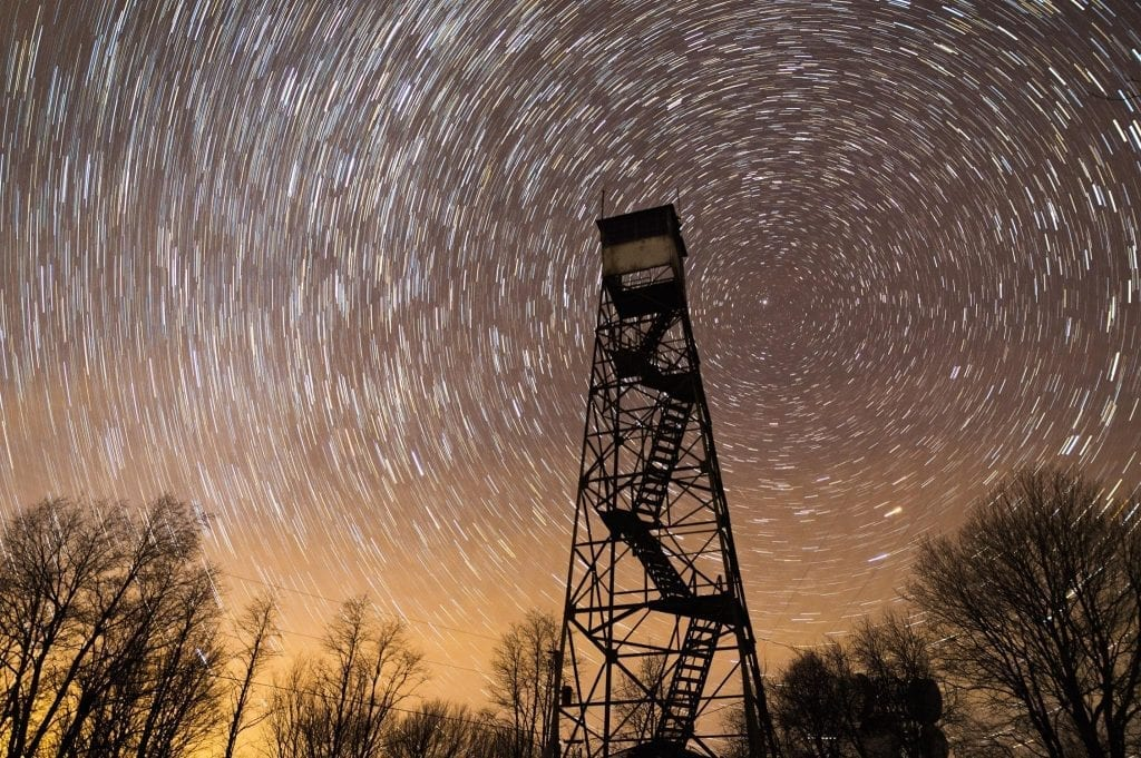 The Mann Mountain Firetower rises into the night sky on Chestnut Knob.